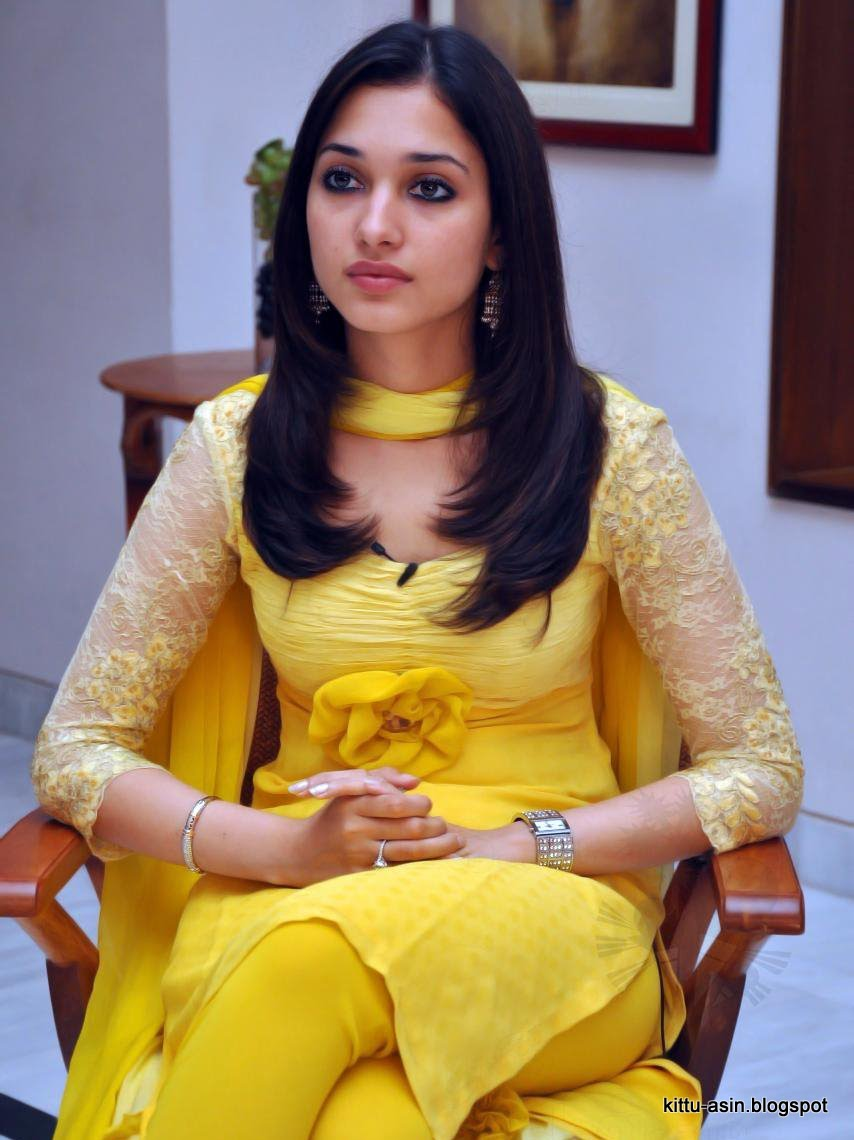 tamanna crossed legged in yellow tight salwar